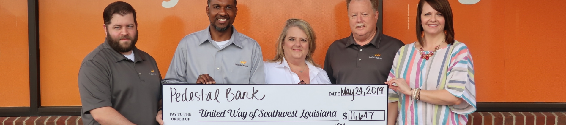Pedestal Bank donates to United Way of SWLA